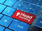 Business concept: Light Bulb and Head Hunting on computer keyboard background