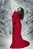 Woman in red dress in snow