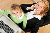 Businesswoman and mother is working in the internet