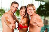 Three friends in public swimming pool
