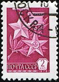 USSR - CIRCA 1976: A stamp printed in the USSR shows Gold Medals Hero of the Soviet Union and Hero of Socialist Labor, circa 1976