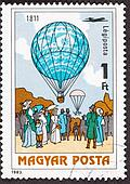 Hungarian Air Mail Postage Stamp. Dr. Menner Dropped Cat With Parachute over side of balloon in 1811.  The cat survived.