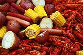 Boiled crawfish with corn, potatoes and hot dogs.