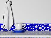 the plates, cups and towels