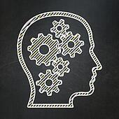 Advertising concept: Head With Gears on chalkboard background