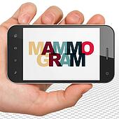 Healthcare concept: Hand Holding Smartphone with Mammogram on  display