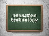 Education concept: text Education Technology on Green chalkboard on grunge wall background, 3d render