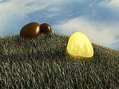 Easter eggs , golden and chocolate eggs laying in the grass , egg hunt