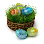 Easter eggs in a basket with a grass