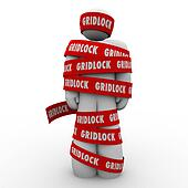 Gridlock red tape wraped around a man or person who is trapped, stopped or prisoner to a challenge, adversity or bureaucracy
