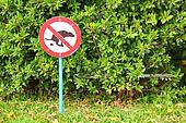 Signs symbolize ban feces dog