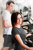 Beautiful girl running on treadmill