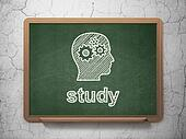 Education concept: Head With Gears and Study on chalkboard background