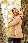 smiling little girl autumn in park