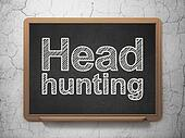 Business concept: Head Hunting on chalkboard background