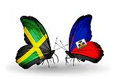 Two butterflies with flags on wings as symbol of relations Jamaica and Haiti