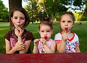 Sisters eating candy