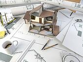 architect drawing table with section model
