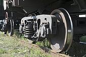 The railway wheels of old soviet cargo wagon.