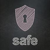 Safety concept: Shield With Keyhole and Safe on chalkboard background