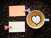 A cup of latte art coffee and clip note
