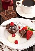 Chocolate muffin served with cream and fresh berris