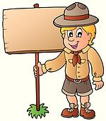 Scout boy holding wooden board