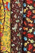 Three bright samples of cotton fabric