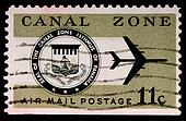 CANAL ZONE, PANAMA - CIRCA 1973: An 11-cent air mail stamp printed in the Canal Zone, Isthmus of Panama, shows the Canal Zone seal and a jet, circa 1973