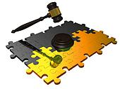 Gavel on metal puzzle.