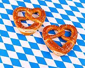 Two pretzel in heart shape on white blue background