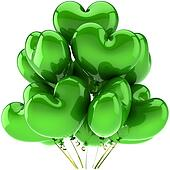 Green birthday balloons as hearts