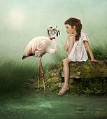 White flamingos and little girl