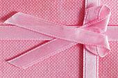 Pink gift box with tied ribbon