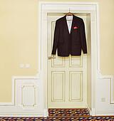 Men's black jacket hanging on a hanger