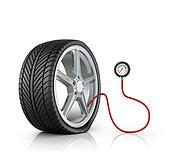 Automotive wheel with lowered pressure sensor on a white background.