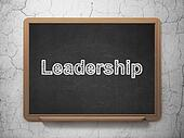 Business concept: Leadership on chalkboard background