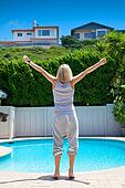 woman's standing near the swimming pool