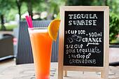 Tequila Sunrise Chalk lettering. Cocktail and recipe on the blackboard.