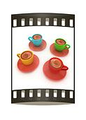 Coffee cups on saucer. The film strip