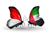 Two butterflies with flags on wings as symbol of relations Monaco, Indonesia and United Arab Emirates