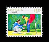 vintage postage stamp of young boy being taught how to play golf