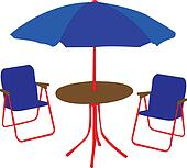 beach chairs, table and umbrella