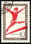 Post stamp shows female gymnast on balance beam