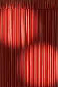 Red theater curtain under two spot lights