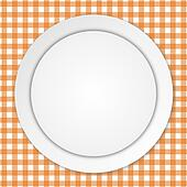 White plate on orange tablecloth