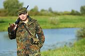 hunter with rifle gun
