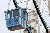 Ferris wheel with blue gondola