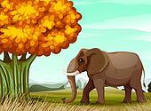 A big brown elephant near the big tree