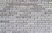 Background texture of a grey brick wall